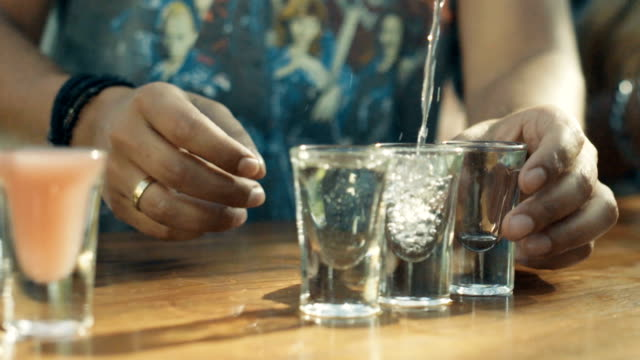 stockvideo's en b-roll-footage met close up van wodka in een shot glas gegoten - alcohol