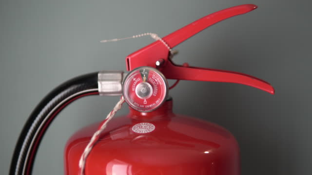 close up of wall mounted fire alarm and fire extinguisher. - fire extinguisher stock videos & royalty-free footage