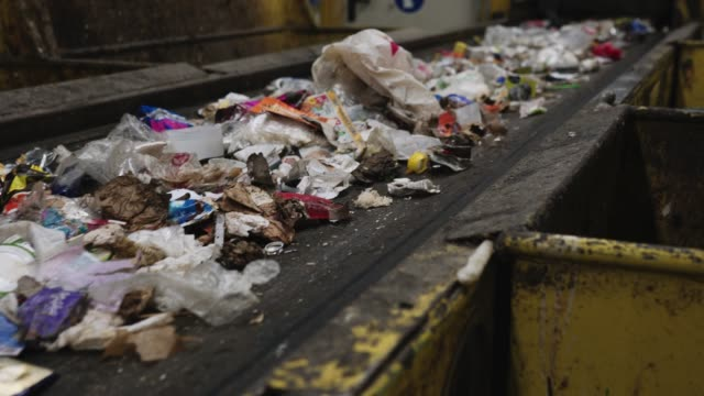 close up of waste on a conveyor belt - rubbish dump stock videos & royalty-free footage