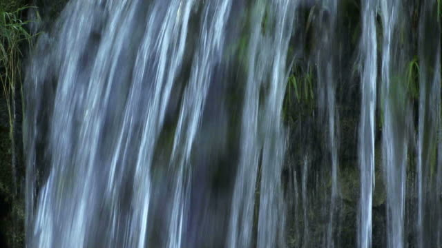 close up of water falling over a rock face. - rock face stock videos & royalty-free footage