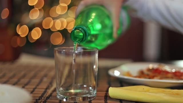 close up of water falling to a glass from a plastic bottle - parte de una serie video stock e b–roll