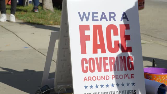 close up of wear a face covering sign at barclay school polling location in baltimore maryland - election stock videos & royalty-free footage