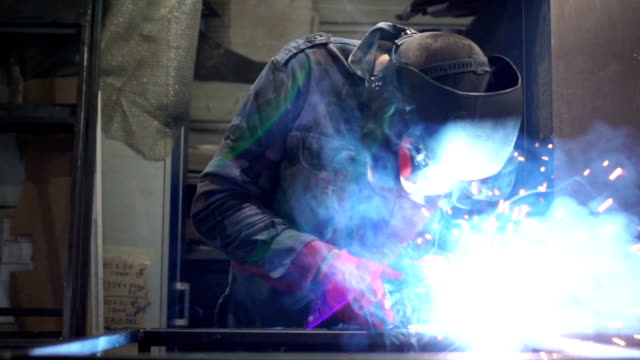 close up of welder working in slow mo - welding stock videos & royalty-free footage
