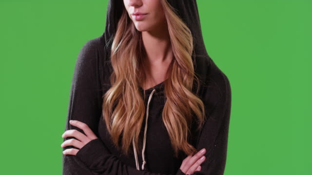 stockvideo's en b-roll-footage met close up of white millennial girl wearing a hoodie on green screen - natuurlijk haar