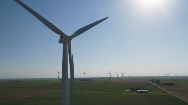 Close up of wind turbine in sunny field