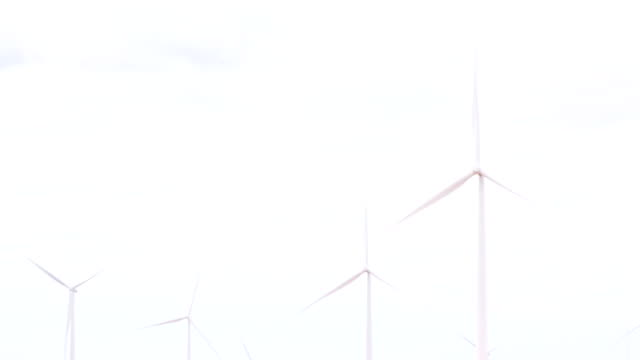 close up of wind turbines moving in the wind - power supply stock videos & royalty-free footage