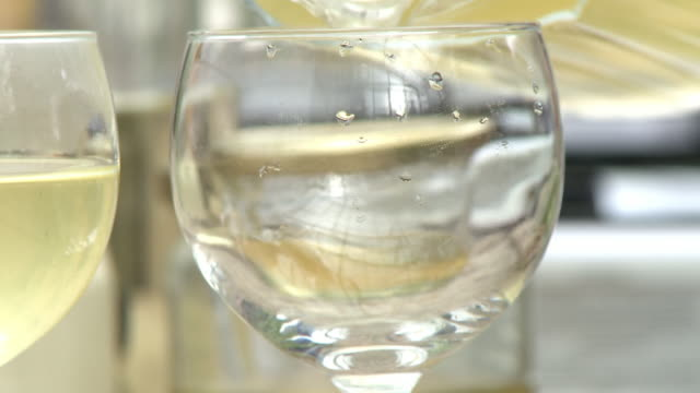 close up of wine being poured into a glass - jug stock videos & royalty-free footage
