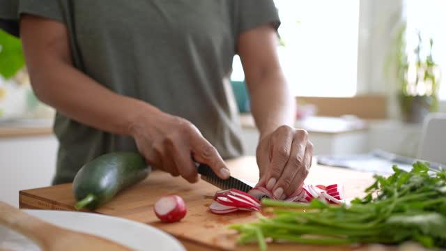 close up of woman cutting radish while preparing vegan summer salad - dieting stock videos & royalty-free footage