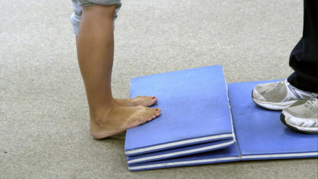 Close up of woman doing calf lift exercises for therapy.