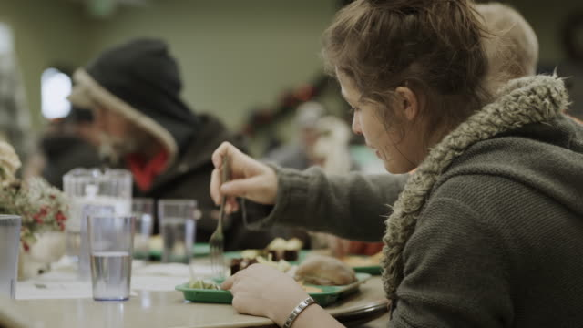 close up of woman eating meal in homeless shelter / provo, utah, united states - canteen stock videos & royalty-free footage