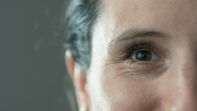 close up of woman face - freude stock-videos und b-roll-filmmaterial