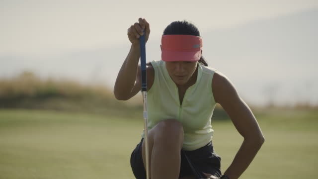 close up of woman golfer putting then celebrating / cedar hills, utah, united states - green golf course stock videos & royalty-free footage