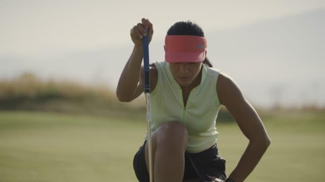 close up of woman golfer putting then celebrating / cedar hills, utah, united states - golf swing stock videos & royalty-free footage