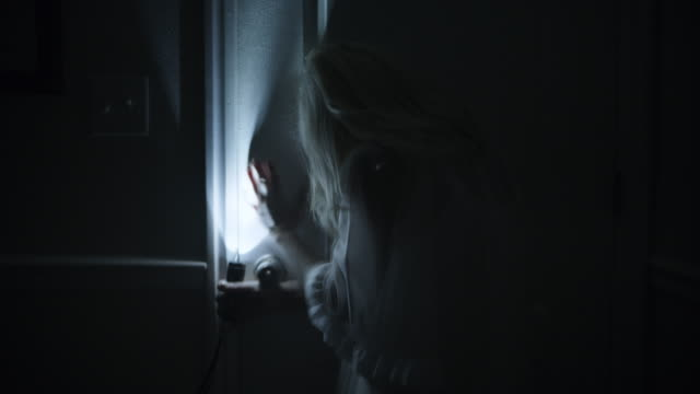 close up of woman hiding behind door from intruder / springville, utah, united states - spooky stock videos & royalty-free footage