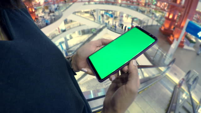 close up of woman holds a smartphone with green screen - market retail space stock videos & royalty-free footage