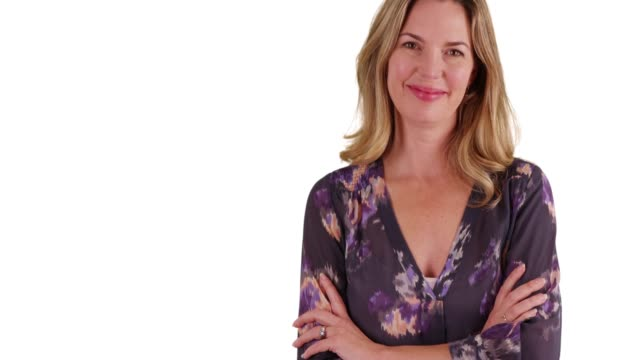 close up of woman in blouse smiling at camera with arms crossed in studio - blouse stock videos & royalty-free footage