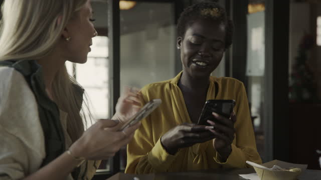close up of woman in restaurant photographing cell phone of sharing friend / pleasant grove, utah, united states - hovering stock videos & royalty-free footage