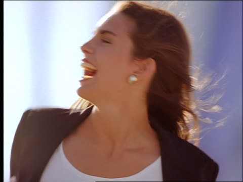 close up of woman laughing - generic location stock videos & royalty-free footage