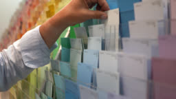 Close up of woman looking at color samples in a hardware store