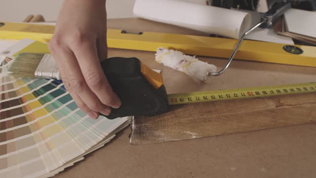 close up of woman measuring a piece of plank with a tape measure - tape measure stock videos & royalty-free footage