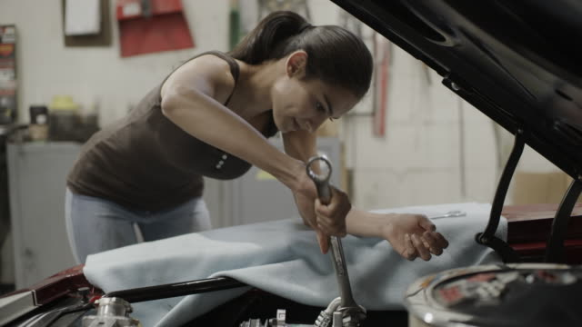 close up of woman mechanic repairing car engine with wrench in garage / pleasant grove, utah, united states - wrench stock videos & royalty-free footage