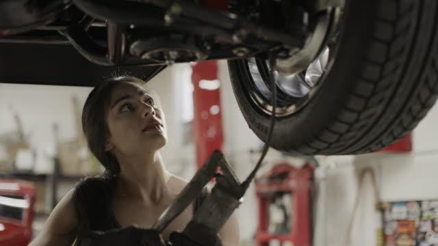 close up of woman mechanic under car bleeding brakes / pleasant grove, utah, united states - lubrication stock videos & royalty-free footage