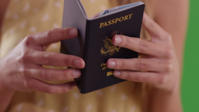 Close up of woman reading passport ready for international travel