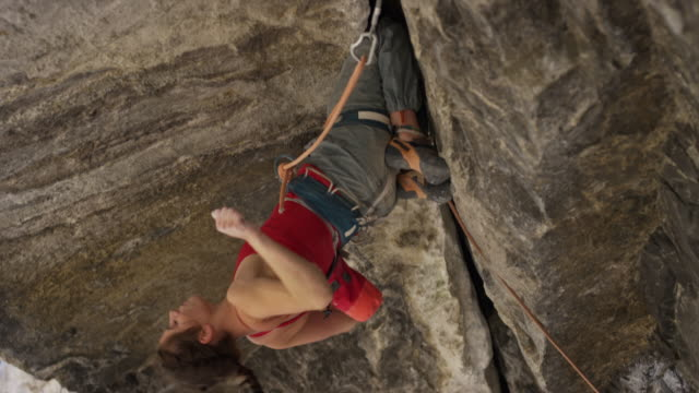 close up of woman rock climbing in cave stretching arms and relaxing / american fork canyon, utah, united states - american fork canyon stock videos and b-roll footage