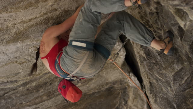close up of woman rock climbing on ceiling of cave / american fork canyon, utah, united states - american fork canyon stock videos and b-roll footage