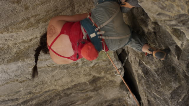 close up of woman rock climbing on ceiling of cave  / american fork canyon, utah, united states - american fork canyon stock videos & royalty-free footage