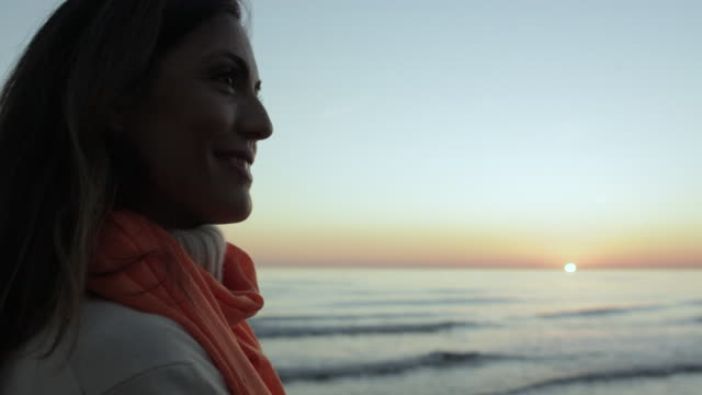 Close up of woman standing beside ocean/Marbella region, Spain