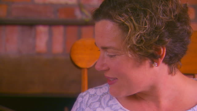 Close up of woman talking, side view