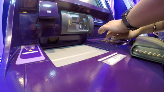 close up of woman using deposit machine - cashpoint stock videos & royalty-free footage