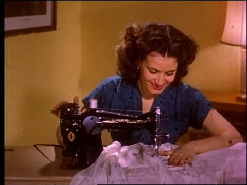 1951 close up of woman using sewing machine - sewing machine stock videos & royalty-free footage
