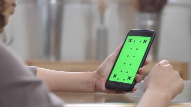 Close up of Woman Using smart phone, Green screen