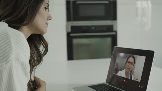 close up of woman video chatting on laptop with doctor / lehi, utah, united states - lehi stock videos & royalty-free footage