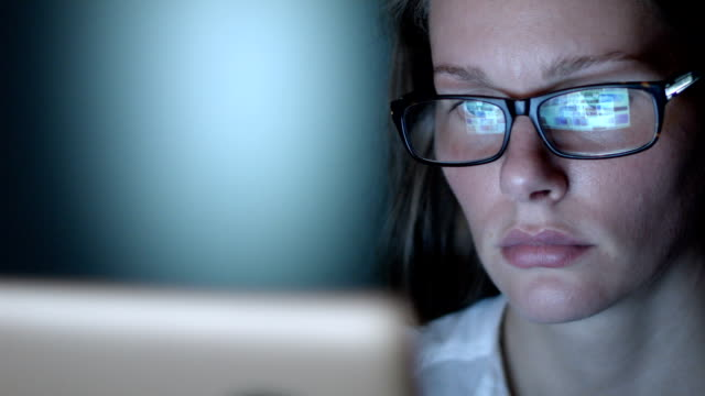 close up of woman with glasses using computer - manövrera bildbanksvideor och videomaterial från bakom kulisserna