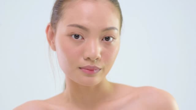 close up of woman with glowing skin making facial expressions - skin feature stock videos & royalty-free footage