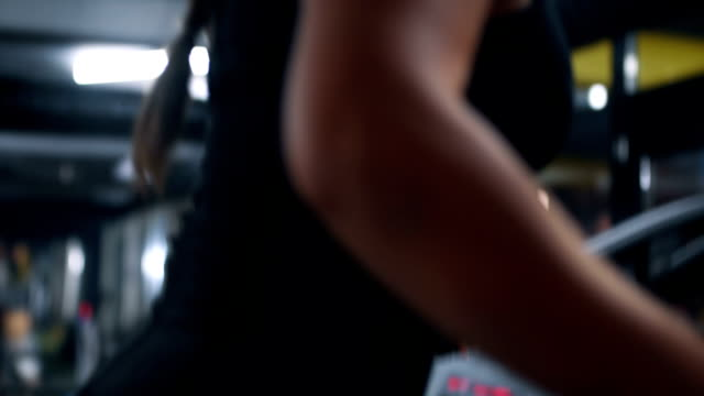 close up of woman working out - cura della persona video stock e b–roll