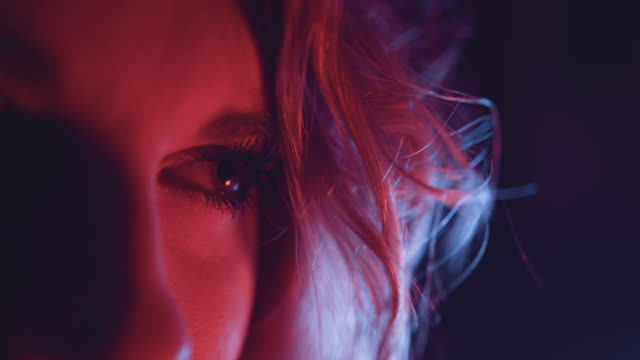 close up of woman's eye in red light - only women stock videos & royalty-free footage