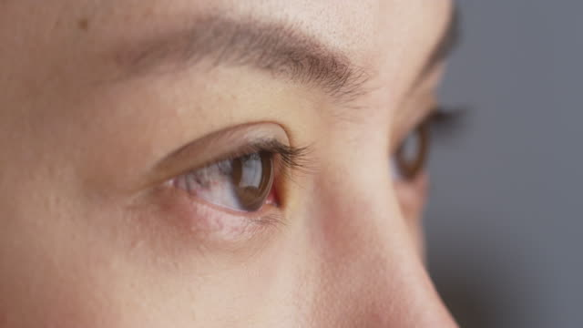 close up of woman's eyes - macro stock videos and b-roll footage