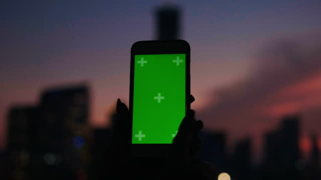 close up of woman's hand while playing game on chroma key green screen of smart phone with bokeh background-night life with leisure activity - game night leisure activity stock videos & royalty-free footage