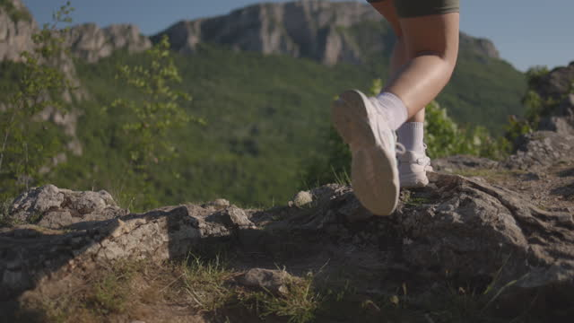 close up of woman's legs while running on rocky mountain range - running shorts stock videos & royalty-free footage