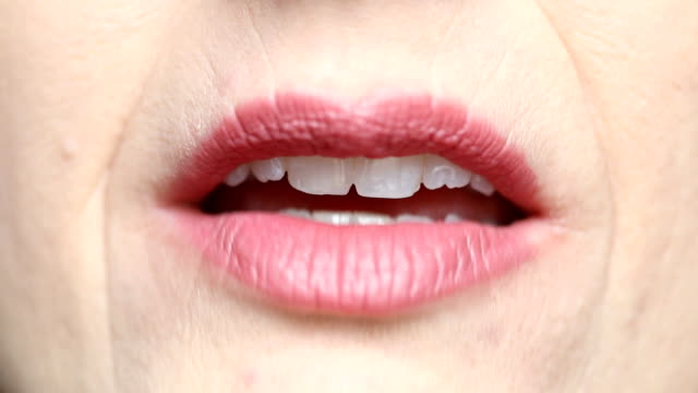 Close Up of Woman's Talking Mouth Front View