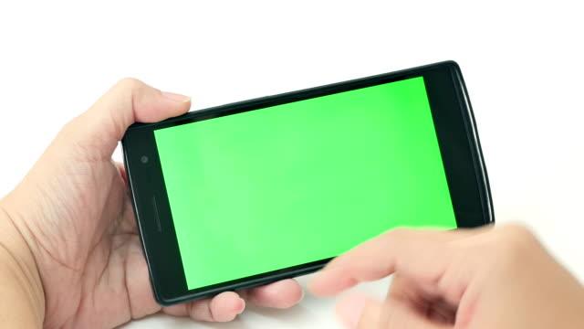 Close up of women using smart phone, Green screen