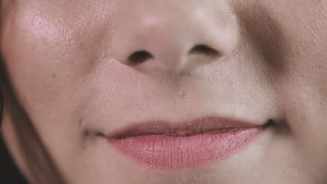 close up of women's face - lips stock videos & royalty-free footage