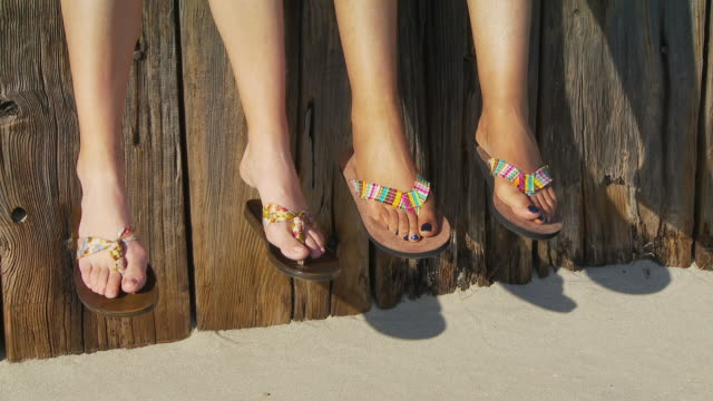 close up of women's feet in sandals - flip flop stock videos and b-roll footage