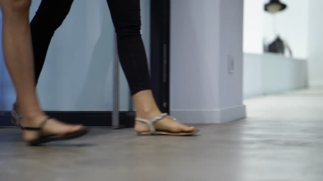 close up of womens feet walking into a clothing store - building entrance stock videos & royalty-free footage