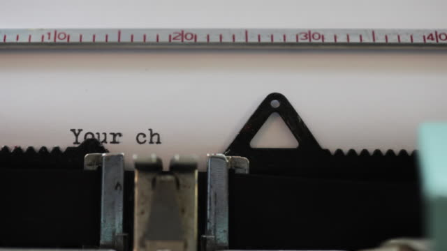 close up of words being typed on old typewriter: 'your cheque is in the post' - scheck stock-videos und b-roll-filmmaterial