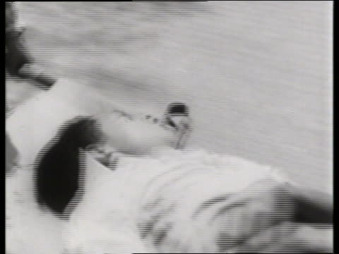 close up of wounded asian person being carried on stretcher / 1960's / saigon / no sound - vietnam war stock videos & royalty-free footage